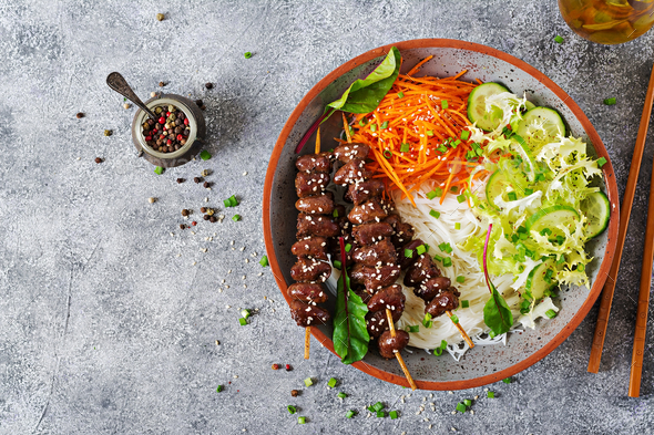 Chicken hearts in spicy sauce, noodles and vegetable salad. Healthy food. Top view - Stock Photo - Images