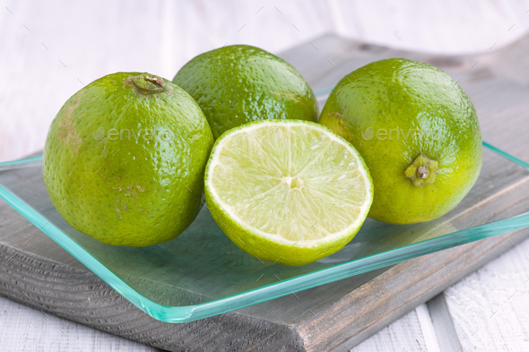 cut limes in glass tray - Stock Photo - Images