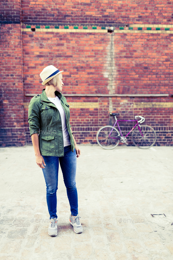 Hipster girl and vintage road bike in city - Stock Photo - Images