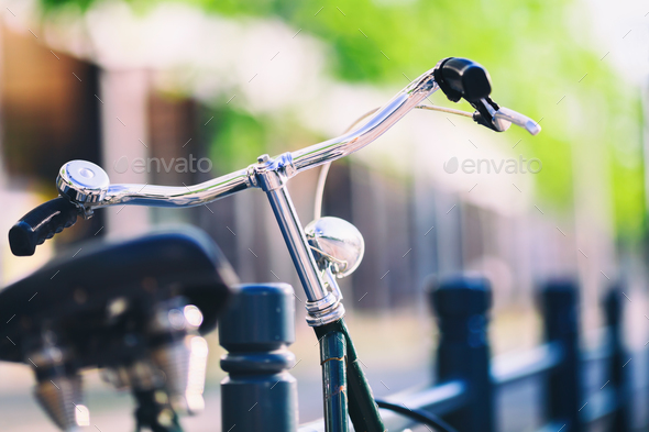 Vintage city bike colorful retro light and handlebar - Stock Photo - Images