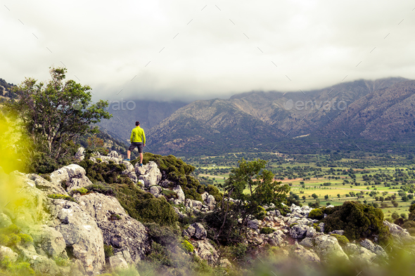 Hiking man looking at beautiful mountains - Stock Photo - Images