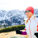 Young woman running in mountains on winter sunny day - PhotoDune Item for Sale