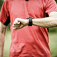 Runner looking at sport or smart watch checking pulse or gps - PhotoDune Item for Sale