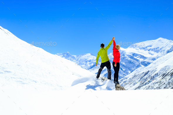 Teamwork motivation, success in winter mountains - Stock Photo - Images