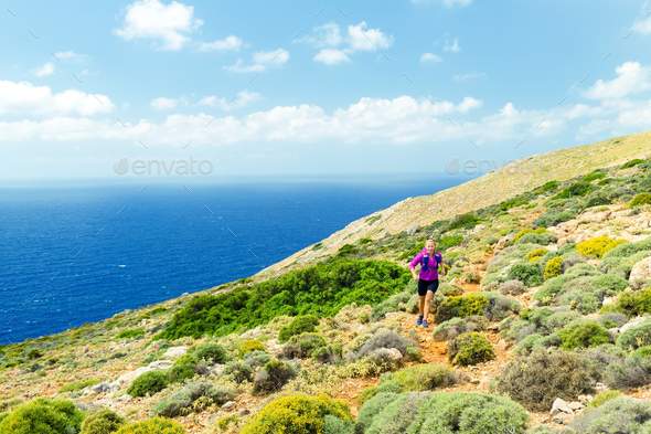 Trail running happy woman in beautiful mountains - Stock Photo - Images