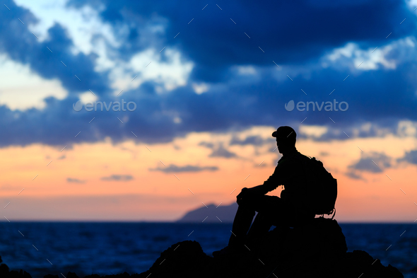 Hiking silhouette backpacker, man trail runner in mountains - Stock Photo - Images