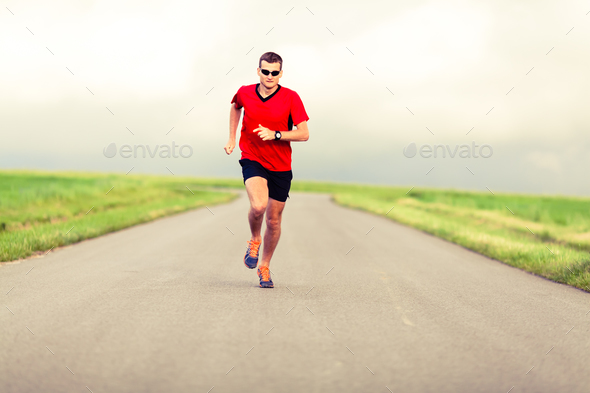 Man running and exercising healthy lifestyle - Stock Photo - Images