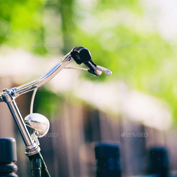 Vintage city bike colorful retro light and handlebar - Stock Photo - Images
