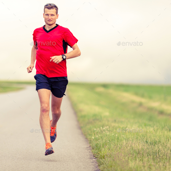 Man running and training healthy lifestyle - Stock Photo - Images