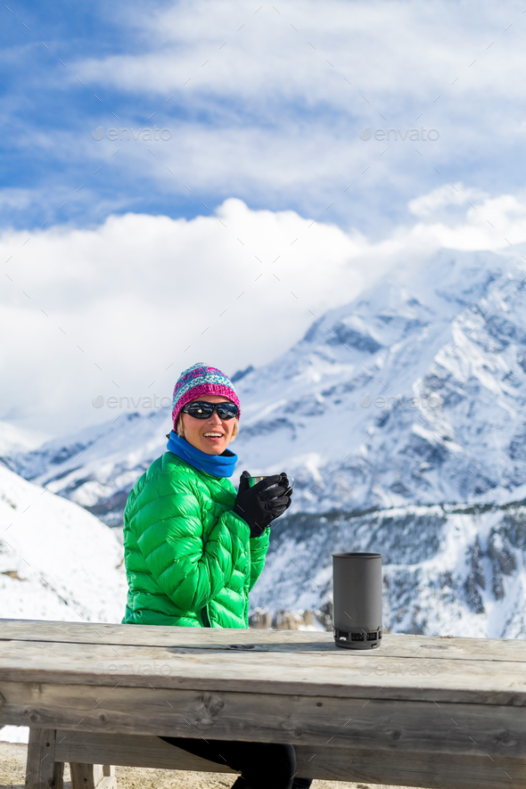 Woman drinking in winter mountain base camp - Stock Photo - Images
