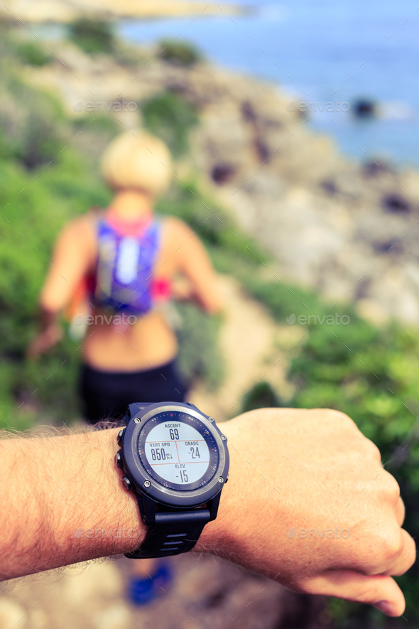 Runner looking at sport watch - Stock Photo - Images
