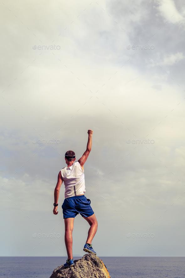 Happy winner reaching life goal success man - Stock Photo - Images