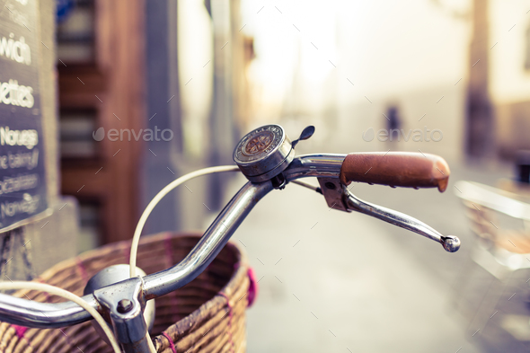 City bicycle handlebar and basket over blurred background - Stock Photo - Images
