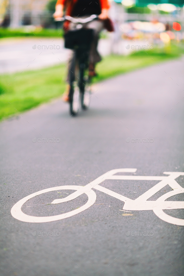 City bike sign on road colorful - Stock Photo - Images