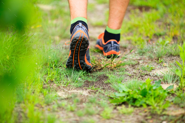 Sports shows running walking on trail - Stock Photo - Images