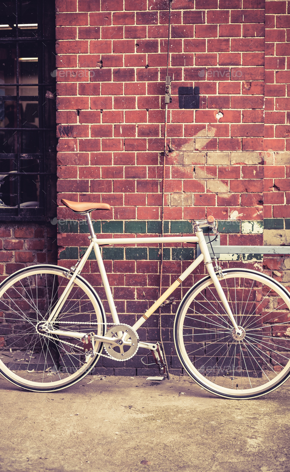 City bicycle on red wall, retro vintage bike - Stock Photo - Images