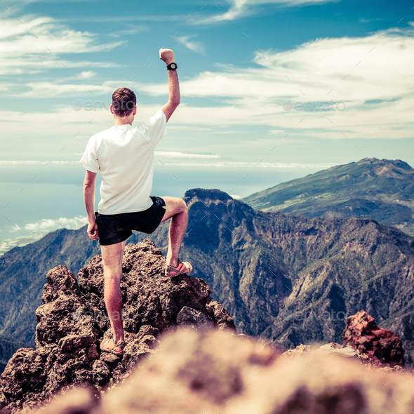 Trail runner success, man running in mountains - Stock Photo - Images