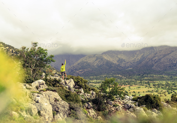 Hiking man looking at beautiful mountains success concept - Stock Photo - Images