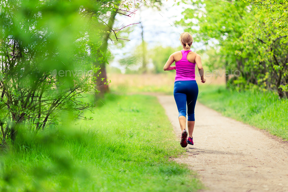 Woman jogging in summer park - Stock Photo - Images