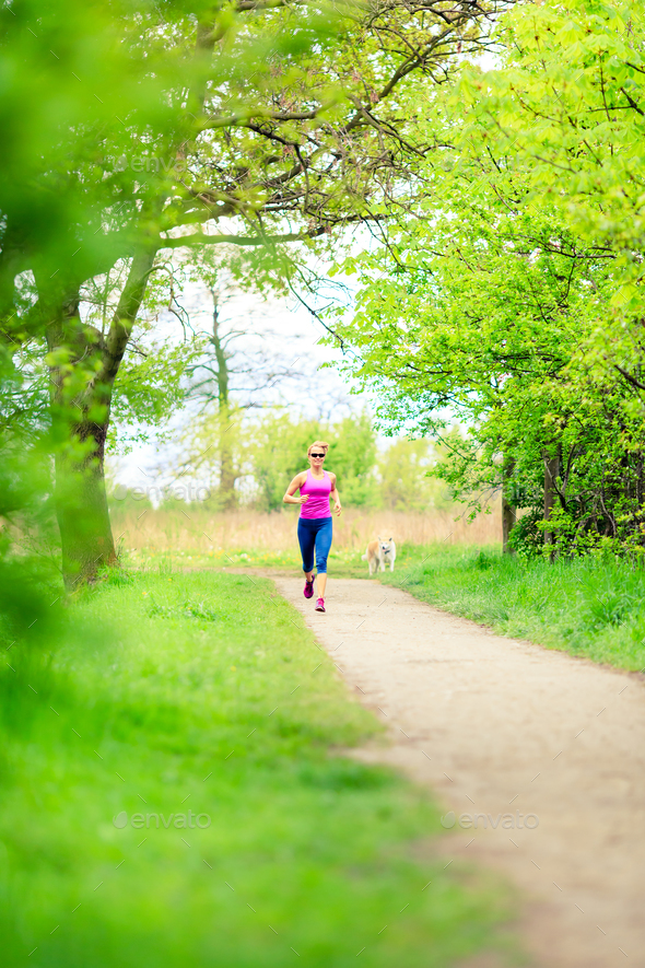 Woman runner running jogging in summer park - Stock Photo - Images