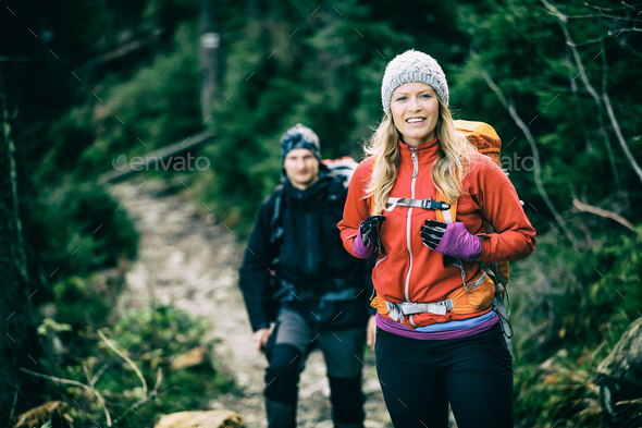 Couple hikers walking hiking - Stock Photo - Images