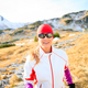 Happy woman running in mountains on winter fall sunny day - PhotoDune Item for Sale
