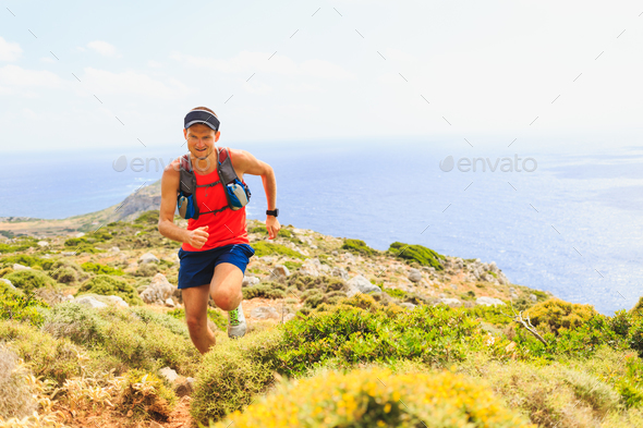 Happy trail running man in beautiful mountains - Stock Photo - Images