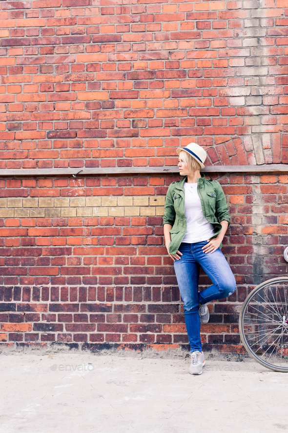 Hipster woman with vintage road bike in city - Stock Photo - Images