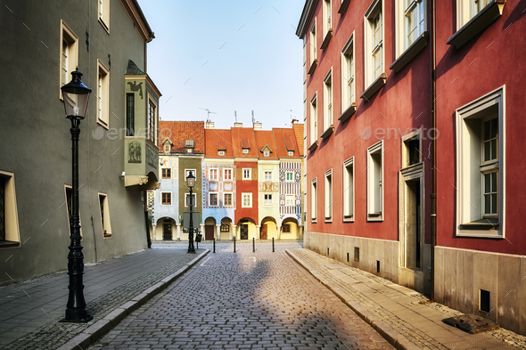 Street to the Poznan Old Market Square at sunrise, Poland. - Stock Photo - Images