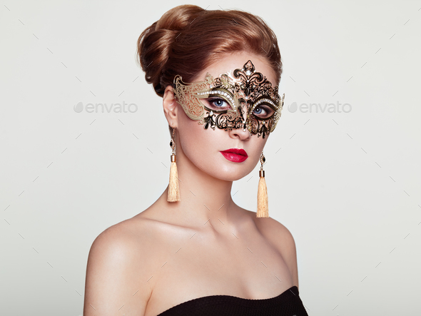 Beautiful woman in venetian masquerade mask - Stock Photo - Images