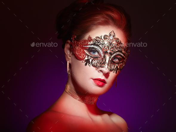 Beautiful woman in venetian masquerade mask - Stock Photo - Images