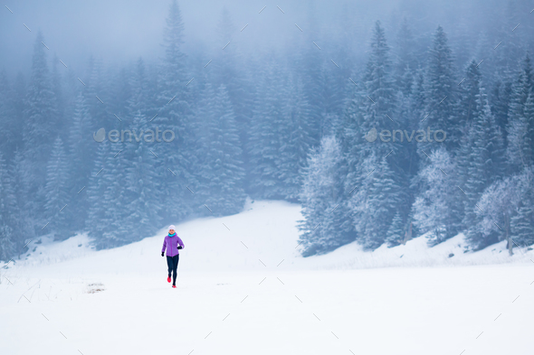 Winter running woman, jogging inspiration and motivation - Stock Photo - Images