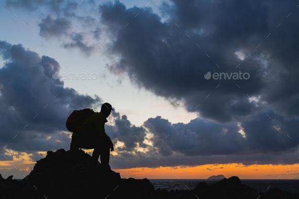 Man silhouette backpacker, inspirational ocean landscape - Stock Photo - Images