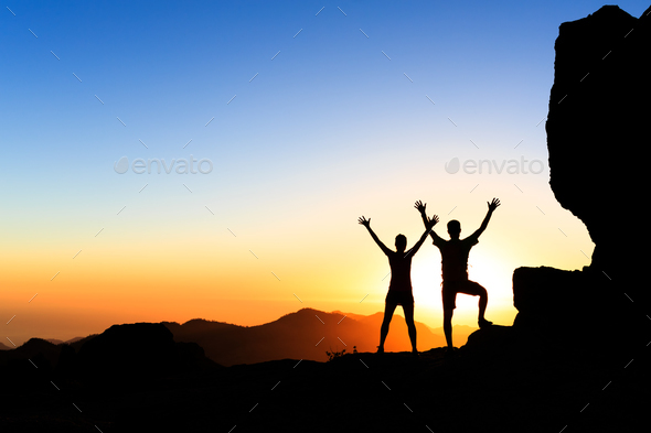 Couple hikers success concept in mountains - Stock Photo - Images
