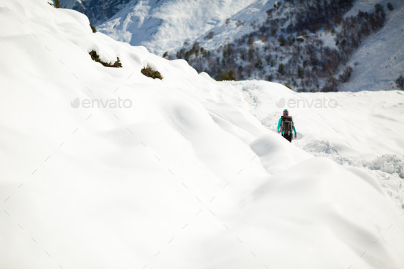 Woman hiking in white winter mountains - Stock Photo - Images