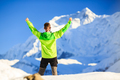 Man hiker or climber achievement in winter mountains
