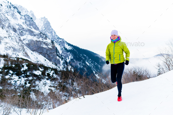 Woman running in winter, fitness inspiration and motivation - Stock Photo - Images