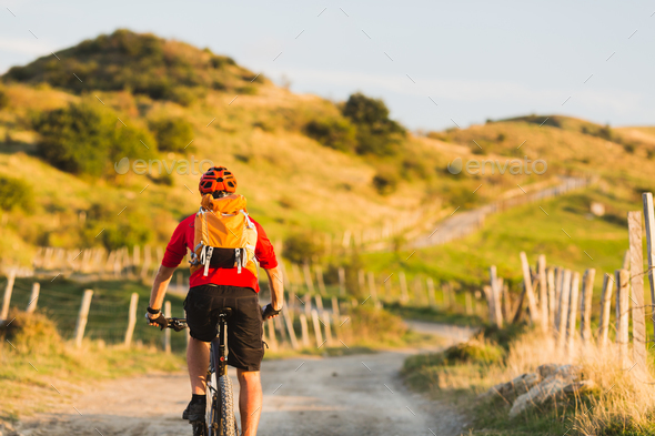 Bicycle riding enduro adventure in sunset mountains - Stock Photo - Images