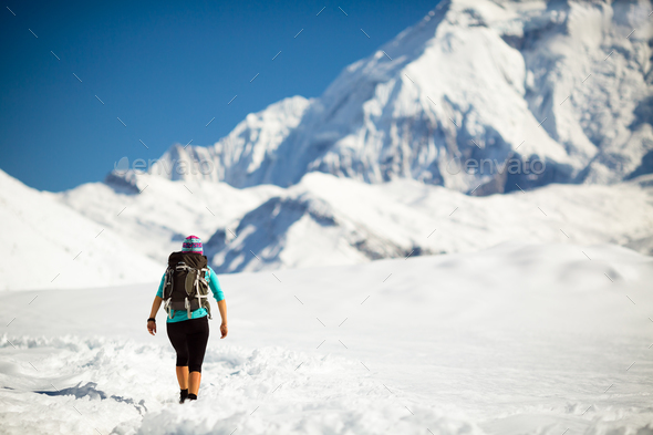 Woman walking in winter mountains - Stock Photo - Images