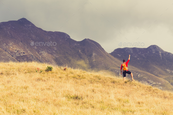 Hiking success, man runner in mountains - Stock Photo - Images