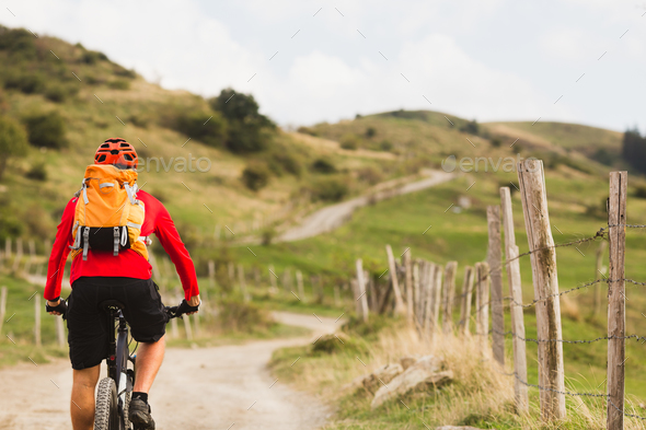 Biker cycling in beautiful mountains - Stock Photo - Images