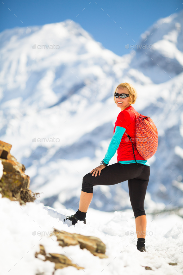 Woman hiker looking at inspirational landscape - Stock Photo - Images