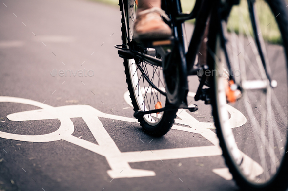 City bicycle riding on bike path - Stock Photo - Images