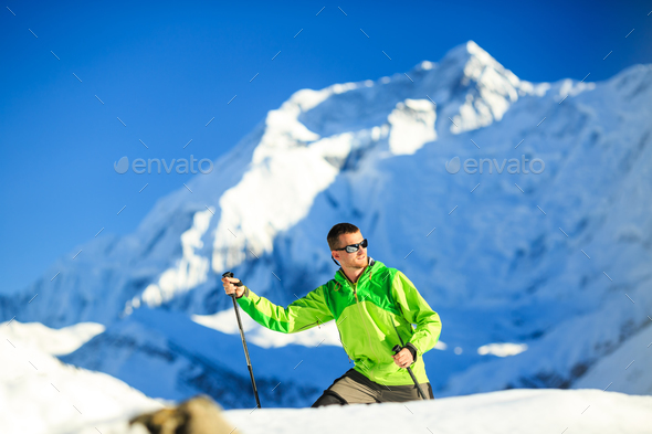 Man hiking in Himalaya Mountains in Nepal - Stock Photo - Images