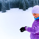 Woman runner checking sports watch on winter run - PhotoDune Item for Sale