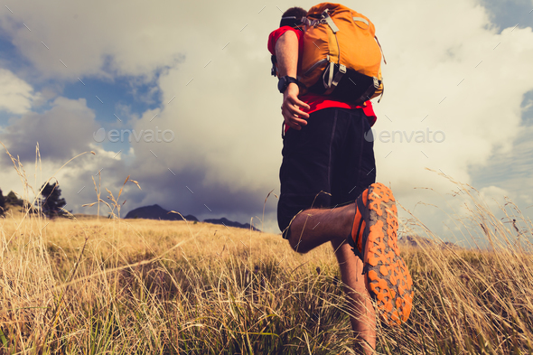 Hiker walking with backpack - Stock Photo - Images