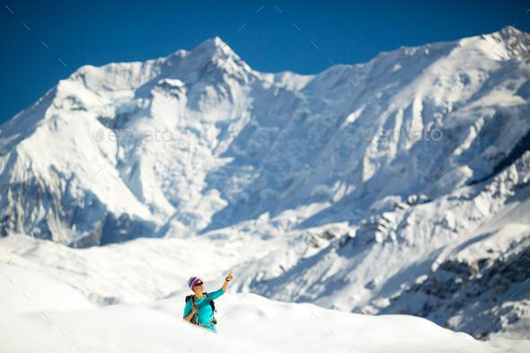 Woman success portrait on mountain peak - Stock Photo - Images