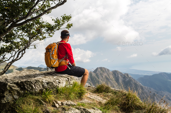Hiker in mountains looking at view - Stock Photo - Images