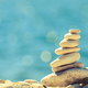 Stones balance at the beach, stack over blue sea - PhotoDune Item for Sale