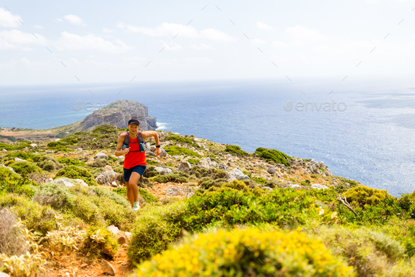 Happy trail running man in inspirational mountains - Stock Photo - Images